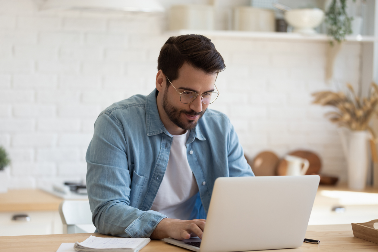 head-shot-young-businessman-working-remotely-with-computer
